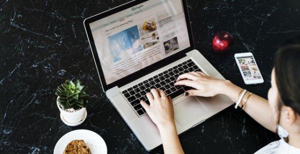 woman writing on a blog